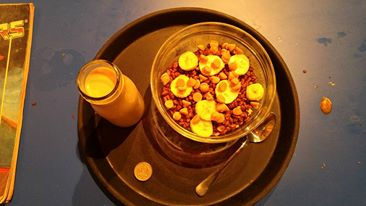 gluten free coco rice, topped with peanut butter chips, bananas, and hazelnut milk!