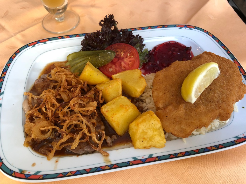 Incredible roast beef with fried potatoes and onions and veal Weiner schnitzel