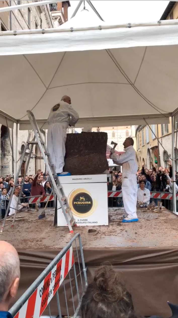 Artists sculpting the huge chocolate blocks with axes!