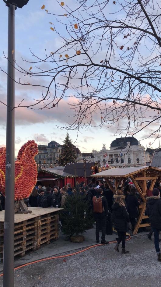 Young adults hanging around the Christmas Market at Sechseläutenplatz